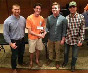 Theta Pi chapter alumni purchase brick for UT Tyler Alumni House