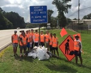 Members of Pi Kappa Phi Fraternity at UT Tyler stand along their Adopt a Highway after finishing a clean up.