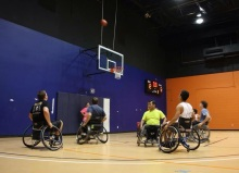 Associate Member Bradley Hudson watches his shot go in the basket during the wheelchair basketball game.