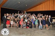 The Theta Pi Chapter and their dates after the Founder's Day Banquet.