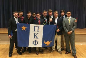 The men of the Pi associate member class after completing their initiation in the Ornelas Activity Center.