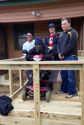 UT Tyler Pi Kapps brave cold temps to build wheelchair ramp 2