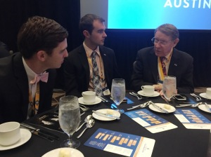 Conway and Miller dining with former Pi Kappa Phi Fraternity Executive Director Greg Elam.